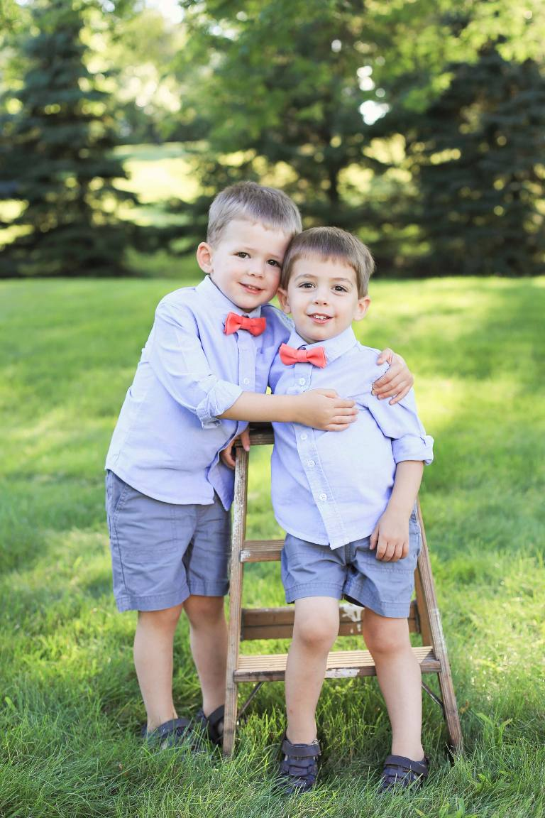 twin brothers outdoors trees bow-ties children family