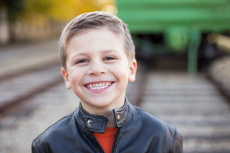 smiling child outdoors train catch lights modern