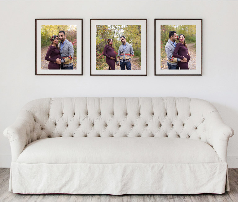 collection of three modern wood frames with prints of expectant husband and wife, pregnant couple in woods with fall foliage