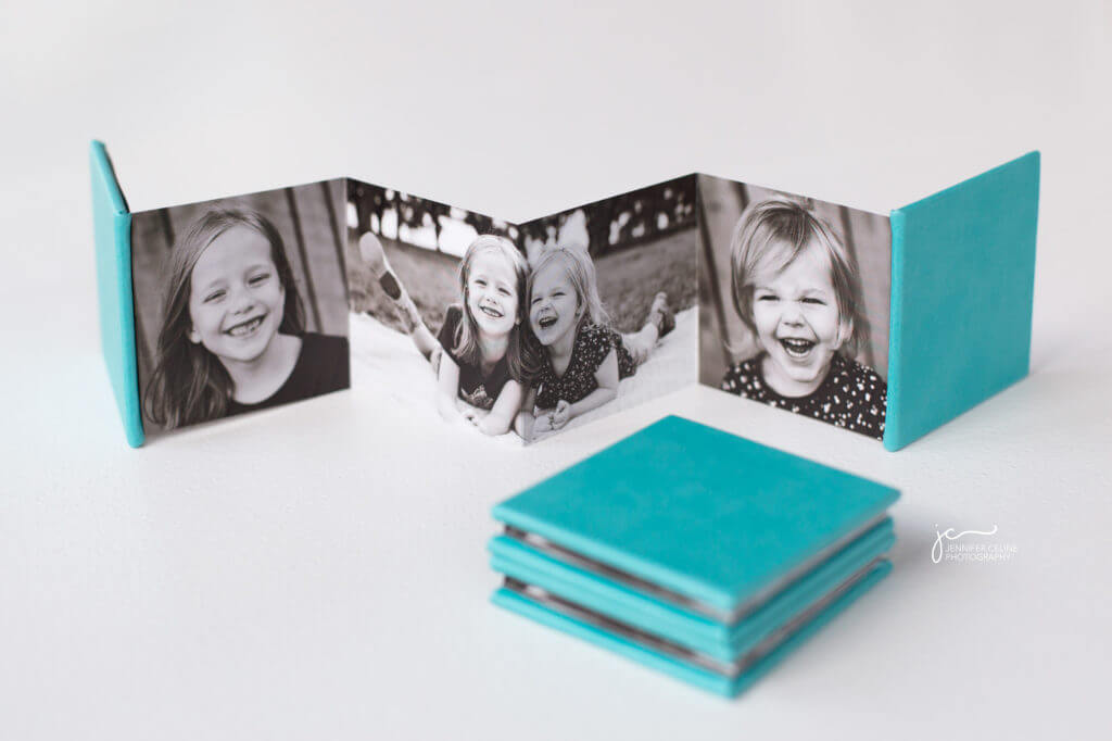 modern black and white children's photos in mini album
