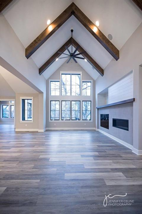 Swoon-worthy custom modern white farmhouse built by CBI Homes/Caritas Builders, entryway exposed wood beams, shiplap, huge wall of windows