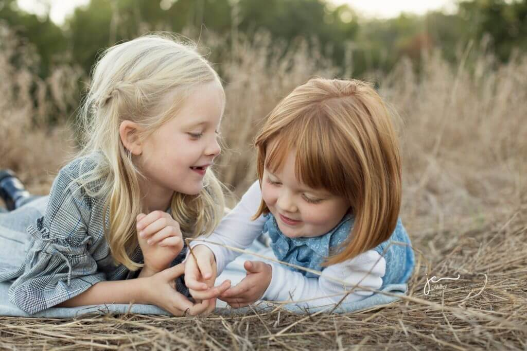 smiling happy sweet sisters outdoors modern natural