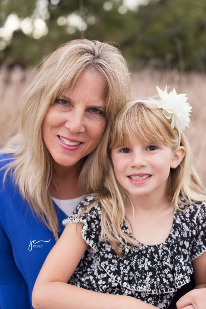 smiling happy mother and daughter outdoors natural