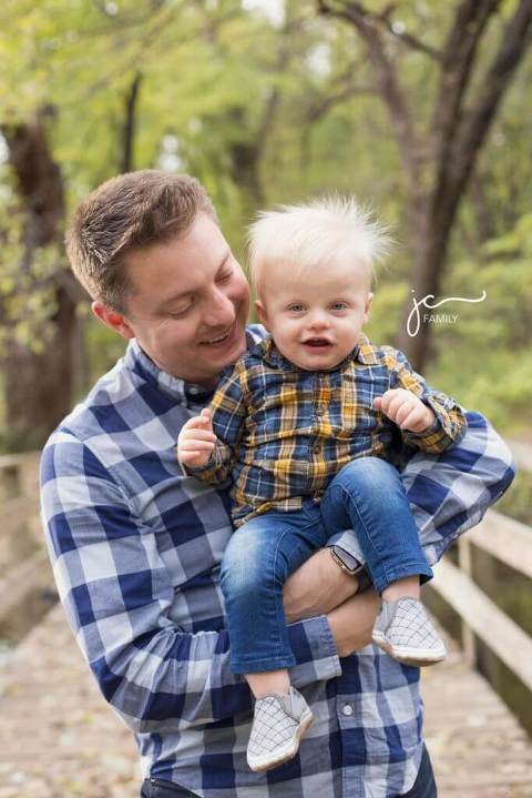 smiling happy father with child outdoors modern natural colorful on bridge