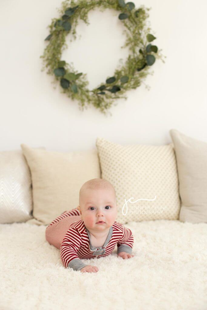 baby on tummy dressed in holiday/Christmas outfit, sweet, modern, simple and festive with wreath