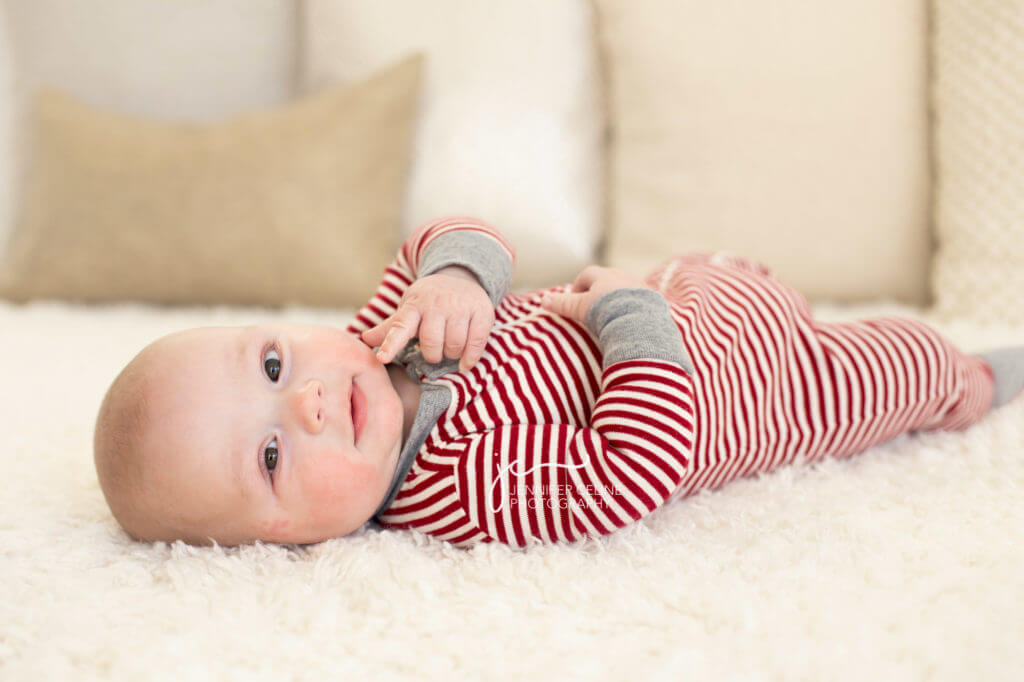 baby dressed in holiday/Christmas outfit, sweet, modern, simple and festive