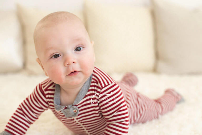 baby on tummy dressed in holiday/Christmas outfit, sweet, modern, simple and festive