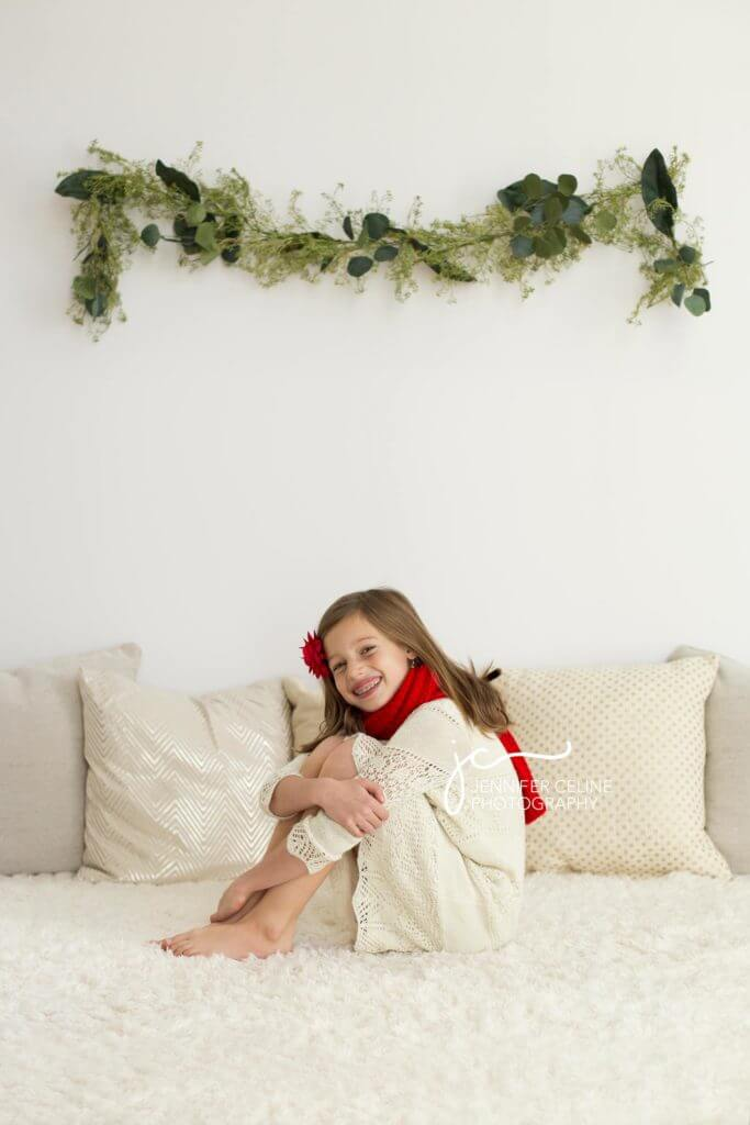 young girl dressed in holiday/Christmas outfit, sweet, modern, simple and festive with garland
