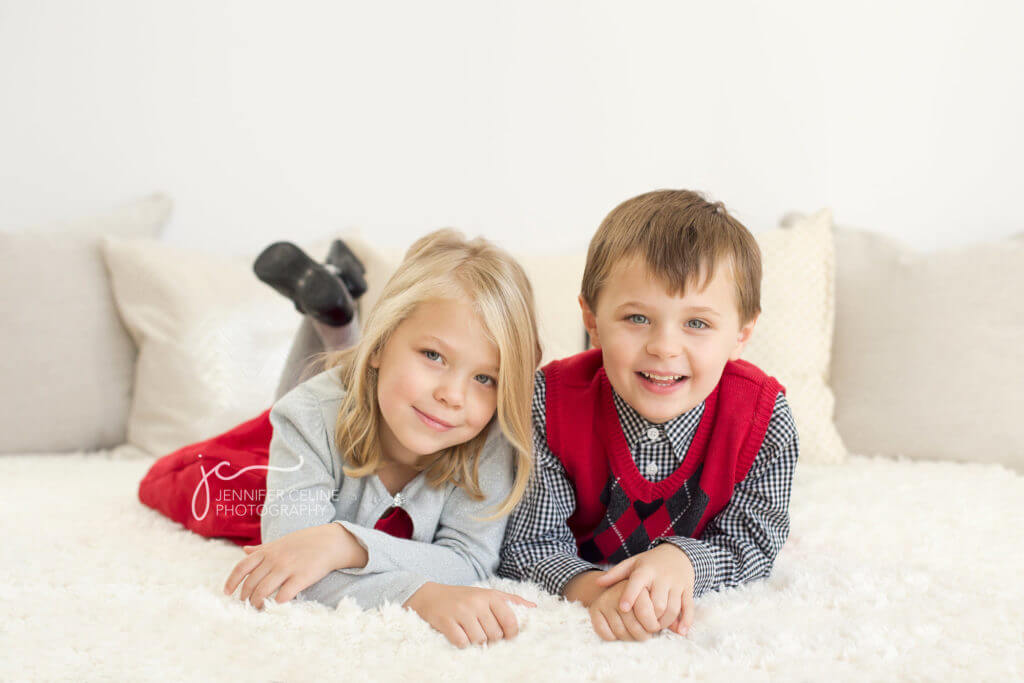 twin boy and girl siblings dressed in holiday/Christmas outfits, sweet, modern, simple and festive
