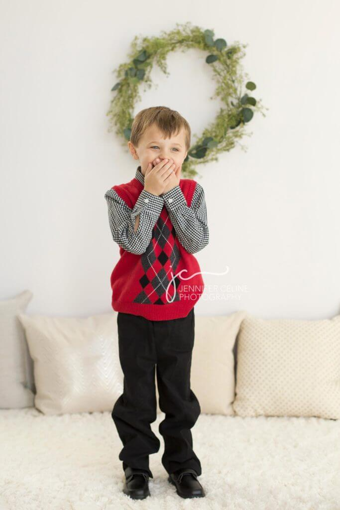 young boy dressed in holiday/Christmas outfits, sweet, modern, simple and festive with wreath