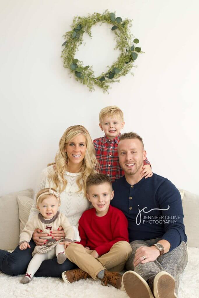 young family of five dressed in holiday/Christmas outfits, sweet, modern, simple and festive