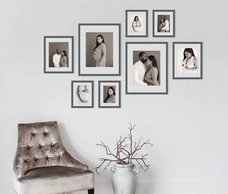 collection of eight modern gray wood frames in various sizes with prints of expectant husband and wife, African American pregnant couple