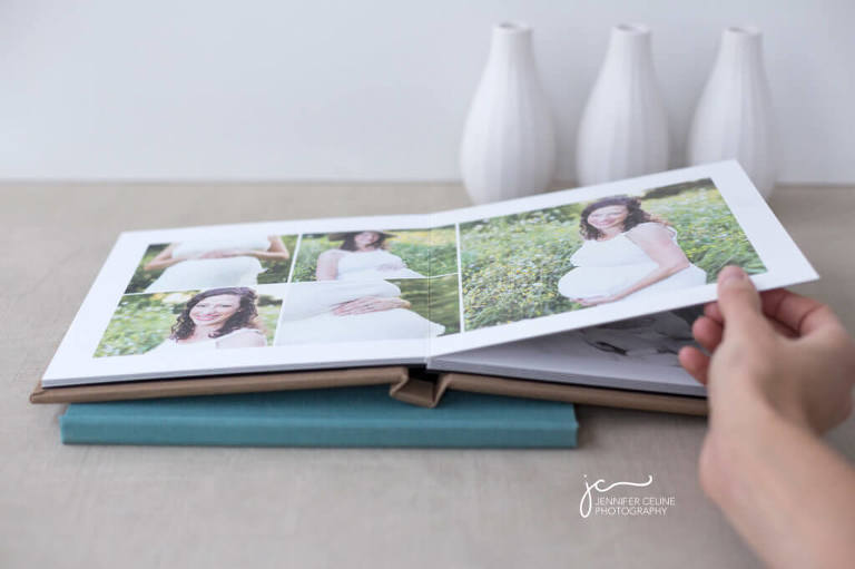 hand opening a modern photography album for newborn, children and family photographs
