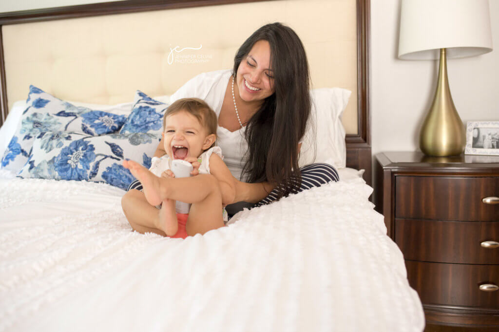 In-home lifestyle maternity session in bedroom with pregnant mom, dad and toddler
