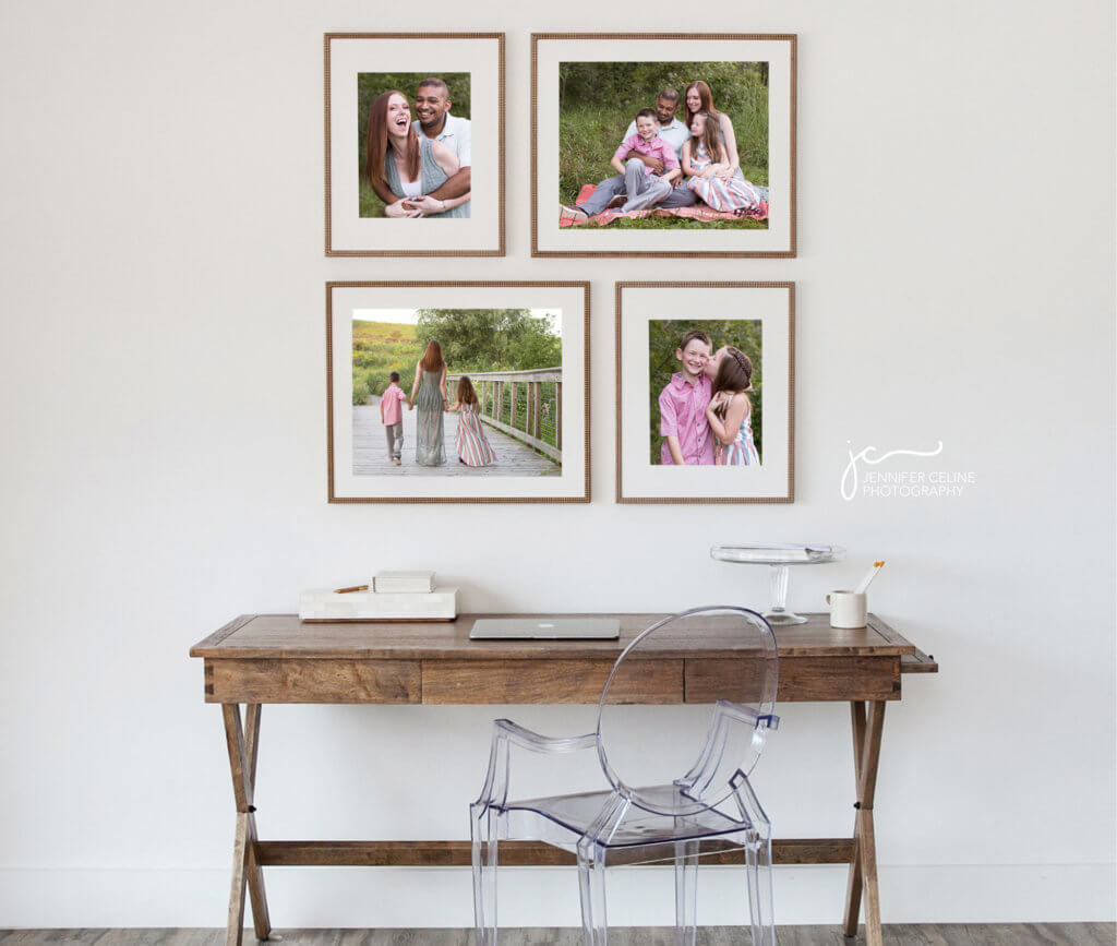 Modern framed photographs displayed over a desk of a happy family of four taken outdoors