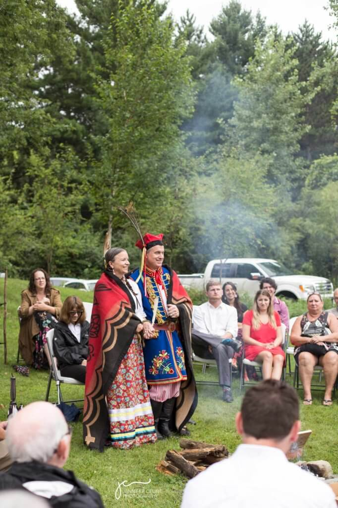 Wedding photograph of couple during traditional Ojibwe ceremony